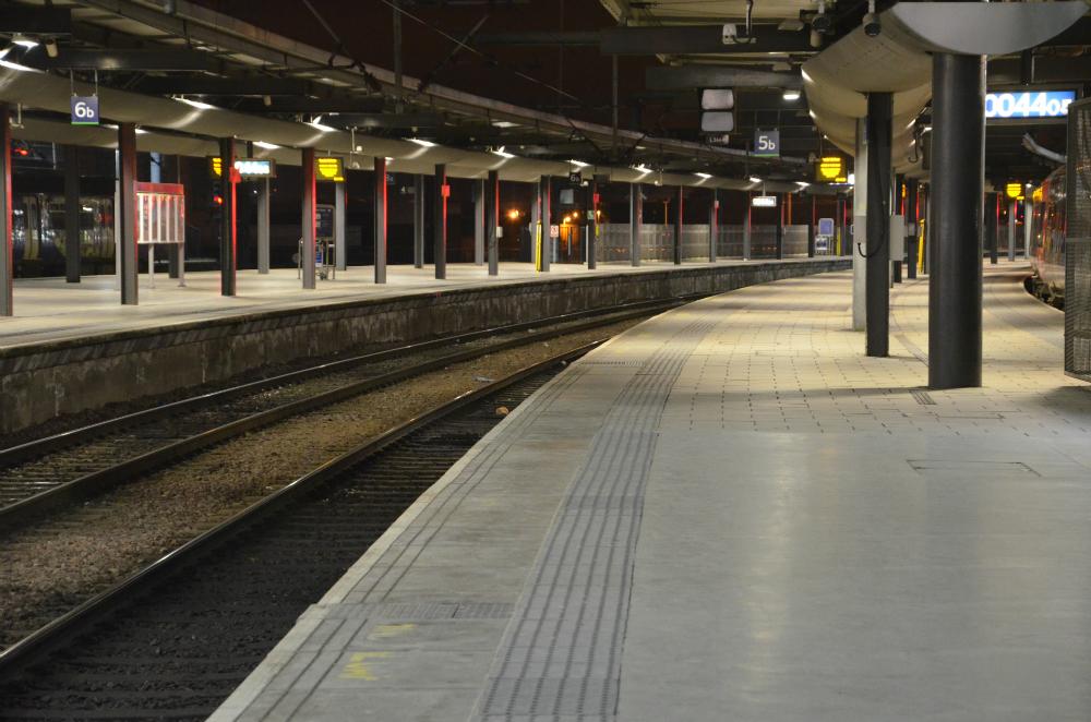 Empty train platform by night